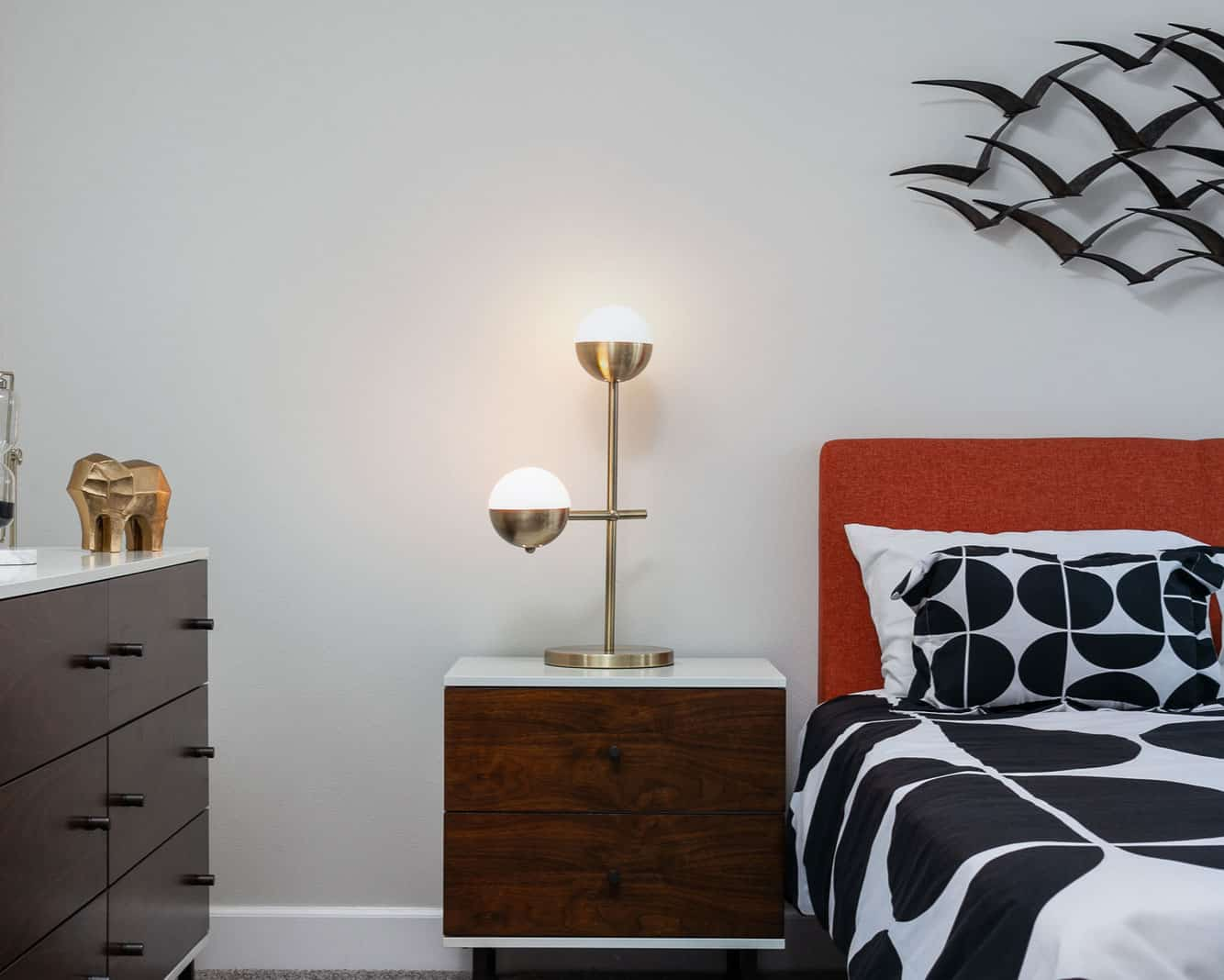 gold circular lamp on a bedside table